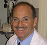 Dr Bloch headshot in office