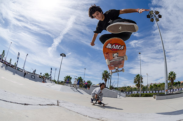 kid on a skateboard flying through the air doing a jump kick flip